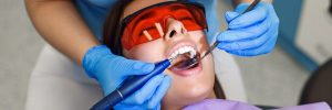 Top view of beautiful young woman with white teeth visits a dentist in a modern clinic. Helthcare concept.
